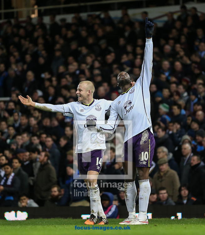 Romelu Lukaku of Everton (right) celebrates scoring his team's second goal against West Ham United to make it 1-2 and points to the sky during the FA Cup match at the Boleyn Ground, London<br /> Picture by David Horn/Focus Images Ltd +44 7545 970036<br /> 13/01/2015