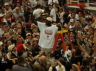 MORNING JOURNAL/DAVID RICHARD.Ohio State center Greg Oden twirls a piece of the net after the Buckeyes' win over Wisconsin for the Big Ten Championship Sunday, Feb. 25, 2007, in Columbus, Ohio. Ohio State beat Wisconsin 49-48.