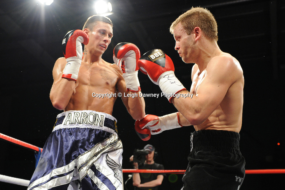 Prince Arron (silver/blue shorts) defeats Sam Webb claiming the British Light middleweight title at Medway Park, Gillingham,13th May 2011. Frank Maloney Promotions. Photo credit © Leigh Dawney.