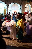 Children dressed as the Virgin Mary and Saint Joseph walk in a posada on Christmas Eve, Oaxaca, Mexico.