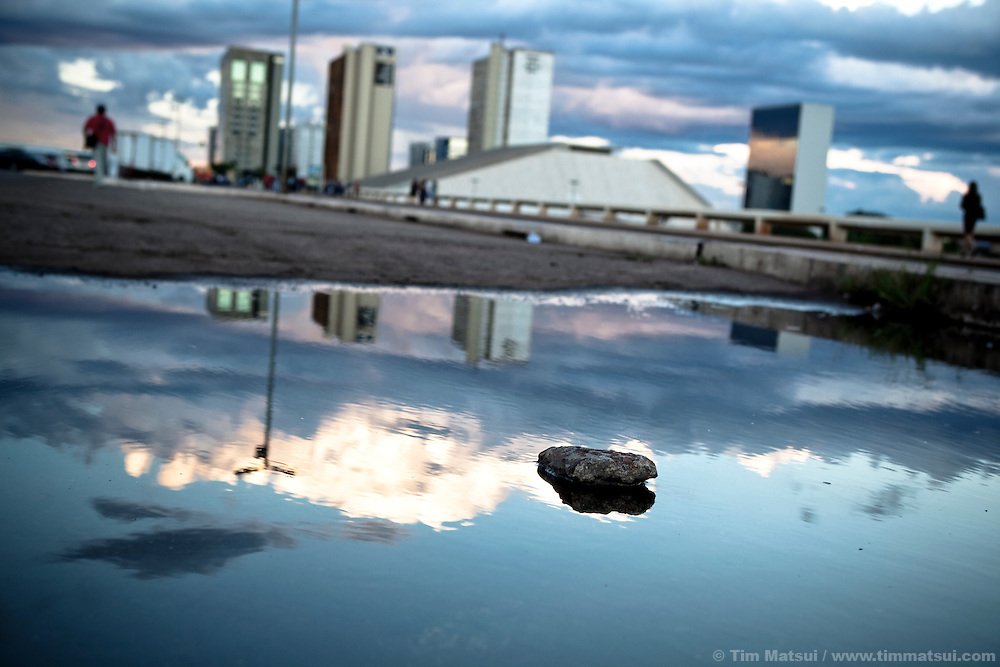 City reflections in a puddle in downtown Brasilia, Brazil.