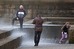 "© Licensed to London News Pictures. 09/11/2015. Bridlington, UK. FRAME 8 OF 9. A man poses for a photograph on the sea defences at the sea side town of Bridlington & gets caught out by a huge wave. The Yorkshire region was hit by severe gales this afternoon with winds up to 60mph. The Met Office warned West Yorkshire to expect gales and locally severe gales over high ground, with some ""very gusty"" winds to the east of high ground as well.<br /> Photo credit: Andrew McCaren/LNP"