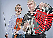2011 MARCH 24 SEATTLE WASHINGTON - Irish musicians Oisin Mac Diarmada, left, and Seamus Begley in Georgetown, Seattle, WA. CREDIT: Richard Walker