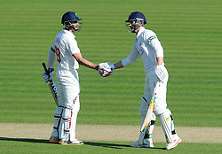 Glamorgan's Craig Meschede and Dean Cosker celebrate their century stand. - Photo mandatory by-line: Harry Trump/JMP - Mobile: 07966 386802 - 21/04/15 - SPORT - CRICKET - LVCC County Championship - Division 2 - Day 3 - Glamorgan v Surrey - Swalec Stadium, Cardiff, Wales.