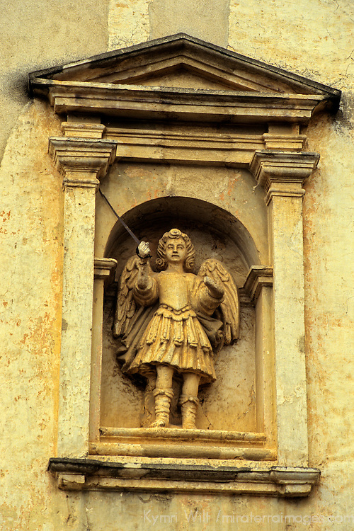 Central America, Guatemala, Antigua. An angel with a sword in the facade of a public building in Antigua.