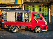 "30 DECEMBER 2015 - BANGKOK, THAILAND:  A ""songthaew,"" a sort of home made bus that is used in small streets in Bangkok, waits for fares at Bang Chak Market. The market is supposed to close permanently on Dec 31, 2015. The Bang Chak Market serves the community around Sois 91-97 on Sukhumvit Road in the Bangkok suburbs. About half of the market has been torn down. Bangkok city authorities put up notices in late November that the market would be closed by January 1, 2016 and redevelopment would start shortly after that. Market vendors said condominiums are being built on the land.           PHOTO BY JACK KURTZ"