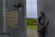 Sculpture by Adam Hall depicting the Great Hunger, or the Great Famine, between Lahinch and Ennistymon. It reads:....Gentlemen,....There is a little boy named Michael Rice of Lahinch aged about 4 years. He is an orphan, his father having died last year and his mother has expired on last Wednesday night, who is now about being buried without a coffin!! Unless ye make some provision for such. The child in question is now at the Workhouse Gate expecting to be admitted, if not it will starve.....Robs.S. Constable..