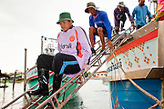 Oct. 6, 2009 -- SAMUT SAKHON, THAILAND: Burmese crew members of Thai owned fishing trawlers leave their boats in Samut Sakhon, Thailand, after a night in the Gulf of Siam, Oct. 6. The Thai fishing industry is heavily reliant on Burmese and Cambodian migrants. Burmese migrants crew many of the fishing boats that sail out of Samut Sakhon and staff many of the fish processing plants in Samut Sakhon, about 45 miles south of Bangkok. Migrants pay as much $700 (US) each to be smuggled from the Burmese border to Samut Sakhon for jobs that pay less than $5.00 (US) per day.   Photo by Jack Kurtz / ZUMA Press