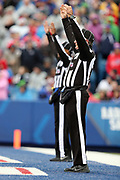 NFL officials raise their arms as they signal that a kick is good during the Buffalo Bills 2016 NFL week 8 regular season football game against the New England Patriots on Sunday, Oct. 30, 2016 in Orchard Park, N.Y. The Patriots won the game 41-25. (©Paul Anthony Spinelli)