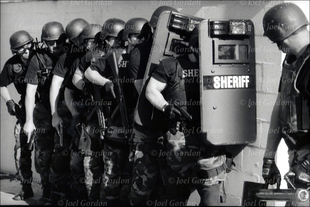Putnam County Sheriff's Office (PCSO) SWAT  in-service training  in riot gear, breaking down door in drug raid.
