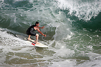 20 June 2006:  Local surfer rides a wave during a South swell reaches the famous surf spot in Newport Beach, CA called The Wedge.  Surfers, boogie boarders, body surfers and crowds gather to watch the powerful waves and the waters take shape into unique sets along the jetty in Orange County, California.  Sequence of 4 images.