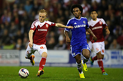 Swindon Forward Alex Pritchard (ENG) shoots during the second half of the match - Photo mandatory by-line: Rogan Thomson/JMP - Tel: 07966 386802 - 24/09/2013 - SPORT - FOOTBALL - The County Ground - Swindon Town v Chelsea - Capital One Cup Round 3.