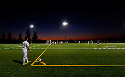 Evening falls on the lighted field for the mens soccer PLU vs. UPS game on Oct. 5, 2012. (Photo/John Froschauer)