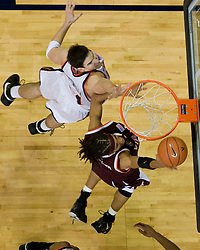 Virginia Tech forward Deron Washington (13) scores over Virginia forward/center Ryan Pettinella (34).  The Virginia Cavaliers men's basketball team fell to the Virginia Tech Hokies 70-69 in overtime at the John Paul Jones Arena in Charlottesville, VA on January 16, 2008.