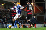 Blackburn Rovers Tom Lawrence challenged by Alejandro Faurlin during the Sky Bet Championship match between Blackburn Rovers and Queens Park Rangers at Ewood Park, Blackburn, England on 12 January 2016. Photo by Pete Burns.