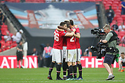 Manchester United Defender Matteo Darmian, Manchester United Midfielder Paul Pogba and Manchester United Midfielder Ander Herrera celebrate victory in front of tv cameras during the The FA Cup Semi Final match between Manchester United and Tottenham Hotspur at Wembley Stadium, London, England on 21 April 2018. Picture by Phil Duncan.