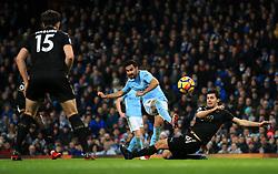 Ilkay Gundogan of Manchester City fires a shot at goal under pressure from Aleksandar Dragovic of Leicester City - Mandatory by-line: Matt McNulty/JMP - 10/02/2018 - FOOTBALL - Etihad Stadium - Manchester, England - Manchester City v Leicester City - Premier League