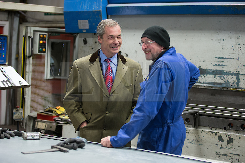 © Licensed to London News Pictures . 23/03/2015 . Middleton , UK . Nigel Farage meets sheet metal worker Brian Gilroy at the factory . UKIP leader Nigel Farage , Deputy Leader Paul Nuttall and Economics Spokesman Patrick O'Flynn announce UKIP's economic policy at Concept Metal Products and Co Ltd in Middleton , Lancashire . Photo credit : Joel Goodman/LNP