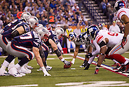 INDIANAPOLIS, IN - FEBRUARY 05:  Dan Connolly #63 of the New England Patriots snaps the ball during Super Bowl XLVI at Lucas Oil Stadium on February 5, 2012. (Photo by Tom Hauck)