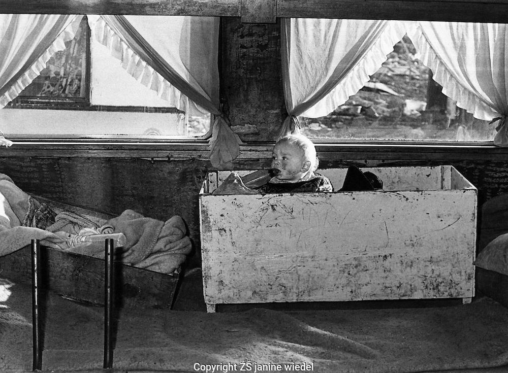 Irish Tinker Traveller baby living in caravan in Southern Ireland in the 1970's.