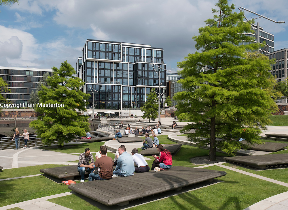 Office workers sitting at Marco-Polo-Terrassen part of modern Hafencity property development in Hamburg Germany
