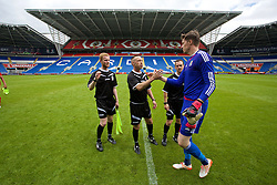 CARDIFF, WALES - Friday, June 5, 2015: Referee Dean John and his assistants Ian Bird and Dan Pearce shake hands with goalkeeper Wayne Hennessey after a practice match at the Cardiff City Stadium ahead of the UEFA Euro 2016 Qualifying Round Group B match against Belgium. (Pic by David Rawcliffe/Propaganda)