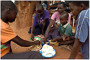 Bea Ahbeck/Fremont Argus<br /> <br /> Scovia Akello, 14, Evelyn Apoko, 13, Concy Akello, 16, Third Adonga,  and Nancy Abot, 16, eat at the GUSCO (Gulu Support the Children Organization) Child Soldier Rehabilitaion Camp Friday, October 28, 2005. Joseph Kony's rebel army LRA (Lord's Resistance Army) have abducted over 20,000 children in the last 18 years of war and turned them into child soldiers, porters or sex slaves. The center has rehabilitated over 2,300 children since its' foudation in 1994 following the abduction of 130 girls from Aboke School in Apac, Northern Uganda in 1996.