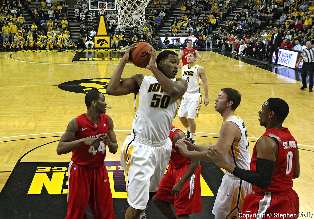 January 04 2010: Iowa Hawkeyes forward Jarryd Cole (50) pulls down a rebound during the first half of an NCAA college basketball game at Carver-Hawkeye Arena in Iowa City, Iowa on January 04, 2010. Ohio State defeated Iowa 73-68.