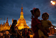 YANGON, MYANMAR - SEPTEMBER 16, 2012.Worshipers visit Botahtaung Pagoda in Yangon, Myanmar on Sep 16, 2012. After nearly five decades where the military had tight control over people's lives, the arrival of democracy has led to debates about a new national identity for the country..(Photo by Kuni Takahashi).