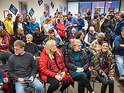 28 DECEMBER 2019 - DES MOINES, IOWA: People wait for Pete Buttigieg before a meet and greet at Urban Dreams. Buttigieg talked to a crowd of about 75 people at Urban Dreams, an African-American community empowerment center in Des Moines. It was a part of Buttigieg's continuing outreach to African-American voters. Buttigieg, the mayor of South Bend, Indiana, is running to be the Democratic nominee for President in the 2020 election. Iowa traditionally holds the first presidential selection event of the 2020 election cycle. The Iowa Caucuses are on Feb. 3, 2020.           PHOTO BY JACK KURTZ