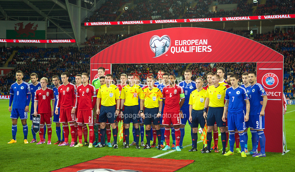 CARDIFF, WALES - Friday, October 10, 2014: Wales and Bosnia and Herzegovina line-up together before the UEFA Euro 2016 qualifying match at the Cardiff City Stadium. (Pic by David Rawcliffe/Propaganda)