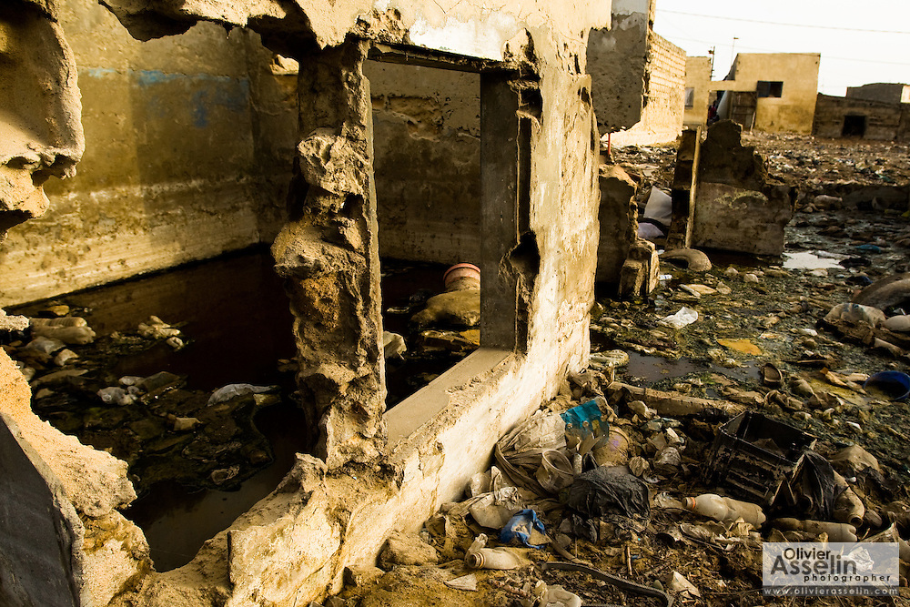 Garbage floats in and around a flooded home in ruins in the Medina Gounass neighborhood of Guediawaye, Senegal on Thursday April 30, 2009.(Olivier Asselin for the New York Times)