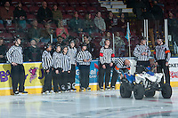 KELOWNA, CANADA -JANUARY 29: Referees stand on the ice as the Kelowna Rockets host the Spokane Chiefs  on January 29, 2014 at Prospera Place in Kelowna, British Columbia, Canada.   (Photo by Marissa Baecker/Getty Images)  *** Local Caption *** referees;