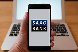 Using iPhone smart phone to display website logo of Saxo Bank