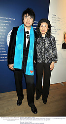 Pianist LANG LANG and his mother XIULAN ZHOU at the Montblanc de la Culture Arts Patronage Award 2009 held at the Tate Modern, Bankside, London SE1 on 16th April 2009.