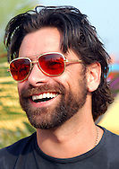 "ATLANTIC CITY, NJ - JUNE 26: Actor John Stamos pose for pictures during the Maxim Magazine Presents ""Fantasy Island"" at the Borgata Hotel Spa and Casino June 26, 2004 in Atlantic City, New Jersey. The event consisted of two music stages and four unique themed areas, providing a wide array of entertainment for guests; South Beach Venice Beach, Stuffland, and The Oasis. (Photo by William Thomas Cain/Getty Images)"