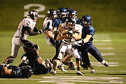 Hurricane High School Tigers running back Adlai Elison is corralled by the Juan Diego High School defense during the 3A Quarterfinal Football between Hurricane and Juan Diego, Friday, Nov. 2, 2012.