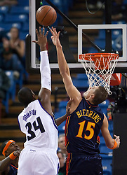 November 8, 2009; Sacramento, CA, USA;  Sacramento Kings forward Jason Thompson (34) shoots over Golden State Warriors center Andris Biedrins (15) during the first quarter at the ARCO Arena. The Kings defeated the Warriors 120-107.