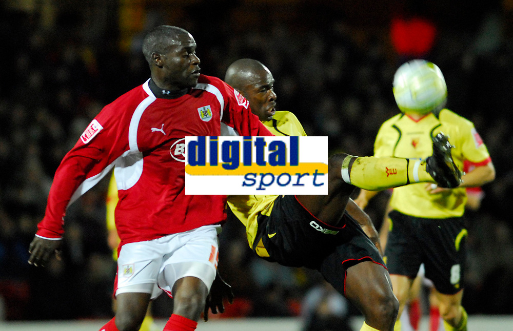 Photo: Leigh Quinnell/Sportsbeat Images.<br /> Watford v Bristol City. Coca Cola Championship. 01/12/2007. Bristol Citys Enoch Showunmi keeps a close eye on Watfords Dan Shittu.