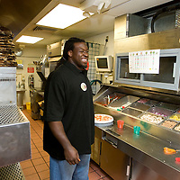 In this photo provided by Pizza Hut, Tampa Bay Buccaneers' offensive lineman Davin Joseph prepares pizza for the lunch crowd while soliciting donations to the World Hunger Relief fund at a Pizza Hut in Pinellas Park, Florida October 21, 2008. Joseph joined three other football players across the country in raising funds in the fight against world hunger. (AP Photo/Scott Audette, Pizza Hut)