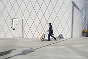 Delivery man with geometric angles and diagonal lines on new architecture at Southwark SE1, on 7th September 2018, in London, England