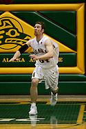 1/13/2006: Junior forward Carl Arts (34) of the UAA Seawolves sets up on defense as he leads Alaska Anchorage to a comeback victory over Northwest Nazarene, 60-57, in men?s basketball action at the Wells Fargo Sports Complex on Saturday.