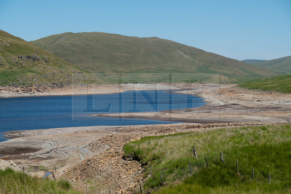 © Licenced to London News Pictures<br /> <br /> Nant y Moch, Ceredigion, Wales UK, 02 July 2018<br /> <br /> UK Weather: After a very long dry and hot spell of weather,  the reservoir at Nant y Moch, just inland of Aberystwyth, has fallen to dramatically low levels last seen in the long hot summer of 1976. <br /> Already, some local properties the nearly village of Ponterwyd, , that draw their water from  wells and springs, have seen their water supplies dry up and disappear <br /> <br /> photo credit Keith Morris / LNP