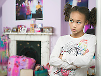 Young Girl leaning against door arms crossed Showing Attitude