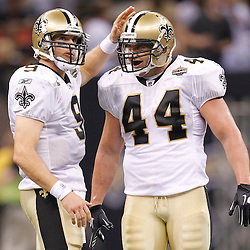 September 9, 2010; New Orleans, LA, USA;  New Orleans Saints quarterback Drew Brees (9) and running back Heath Evans (44) celebrate following a win in the NFL Kickoff season opener over the Minnesota Vikings at the Louisiana Superdome. The New Orleans Saints defeated the Minnesota Vikings 14-9.  Mandatory Credit: Derick E. Hingle