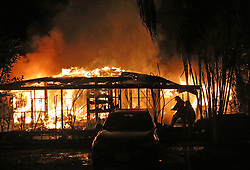 A family has escaped a suspicious fire as two homes were razxed to the ground in Atupa, Rarotonga, Sunday, July 02, 2017. Credit:SNPA / Richard Moore  **NO ARCHIVING**