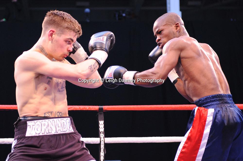 Tyler Goodjohn defeats Mark McKray (blue shorts) at London's Olympia on Saturday 30th April 2011. Matchroom Sport. Photo credit © Leigh Dawney.