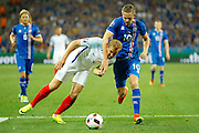 England Forward Harry Kane and Iceland midfielder Gylfi Þór Sigurðsson (10) battle for the ball during the Round of 16 Euro 2016 match between England and Iceland at Stade de Nice, Nice, France on 27 June 2016. Photo by Andy Walter.