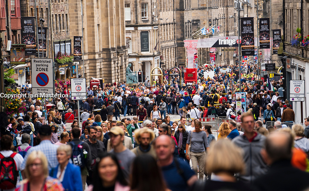 Edinburgh, Scotland, UK. 1 August 2019. Crowds of tourists throng the Lawnmarket and Royal Mile in the Old Town of Edinburgh on the eve of the start of the Edinburgh Festival. Overcrowding by tourists is a growing problem in the ancient city and locals complain it is harder to move around the city because of pedestrian congestion.
