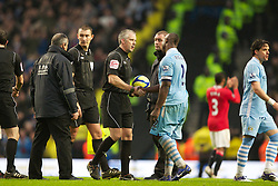 MANCHESTER, ENGLAND - Sunday, January 8, 2012: Manchester City's Micah Richards shakes hands with referee Chris Foy after his side's 2-3 defeat to Manchester United after the FA Cup 3rd Round match at the City of Manchester Stadium. (Pic by Vegard Grott/Propaganda)